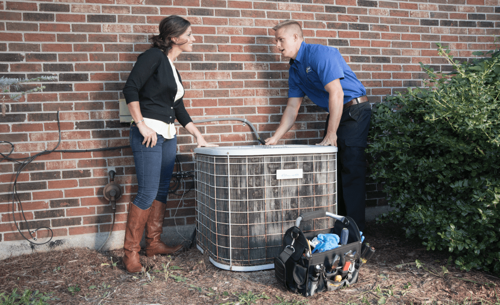 Maeser A/C tech with customer in Louisville