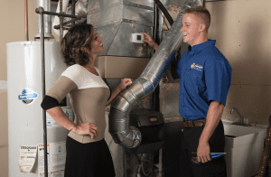 Maeser HVAC tech with customer in Louisville