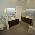 Enlarged bathroom with shower and free-standing tub