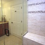 Enlarged shower with bench