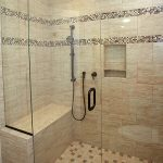 Enlarged shower with bench and niche