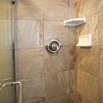 Shower with frameless sliding shower doors