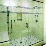 Oversized shower with bench and 3 shower heads