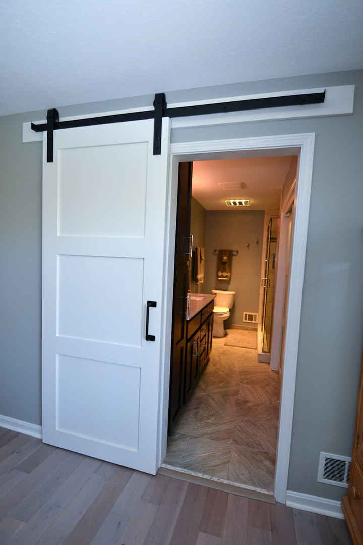 Perfect We Added A Sliding White Barn Door With Wrought Iron Trim.